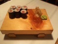 Finished hosomaki roll on sushi plate