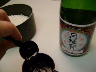 Add 2 tablespoons sake to 2 cup measuring cup and fill remaining with bottled water