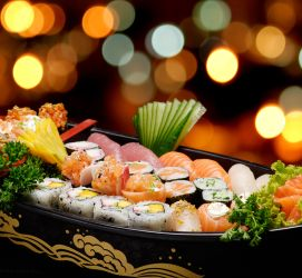 Sushi in a sushi boat with colorful lights in the background
