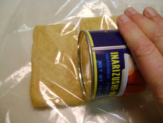 Rolling can over abura age to make it easier to open pocket later