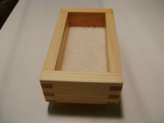 1st layer of rice pressed down