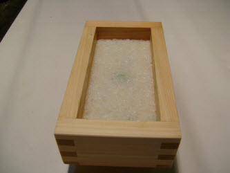 2nd layer of rice pressed down