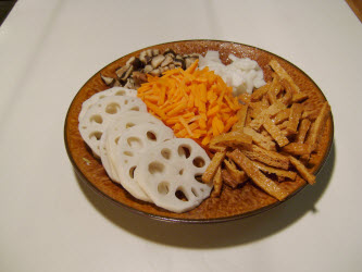 All the uncooked ingredients: Lotus root, carrots, shitake, kampyo gourd strips and inarizushi-no-moto