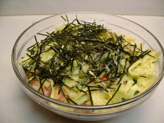 Add the kinshi tamago and kizami nori