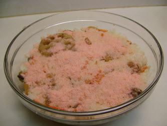 Top the chirashi sushi with sakura denbu