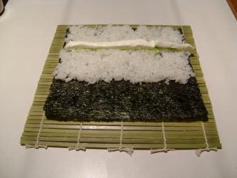Adding cream cheese for chumaki roll