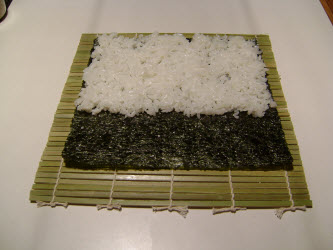 Sushi rice spread on nori for chumaki roll