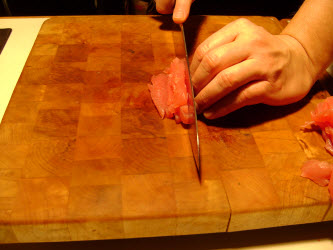 Stacking the 1/4 inch tuna slices and making 1/4 inch matchsticks