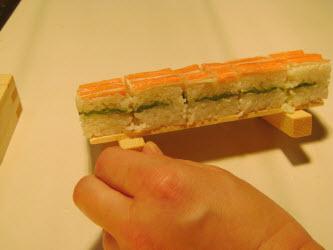 Showing side view of oshi sushi