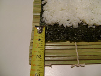 Showing 1 inch strip of bare nori on side farthest away from you