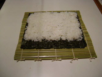 Sushi rice spread on nori for futomaki