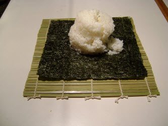 1 and 1/2 cups of sushi rice on nori sheet for futomaki