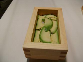 Layering avocado. Make sure to like the dark green edges along the outside