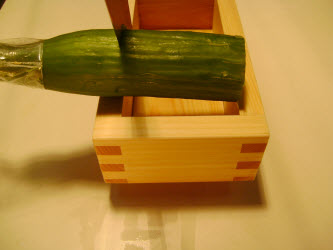 Measuring and cutting to the length the japanese or english cucumber based on the width of the oshibako
