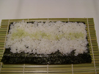 1/2 cup of rice spread on nori with wasabi