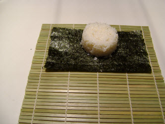 Put the 1/2 cup of rice on the nori sheet...