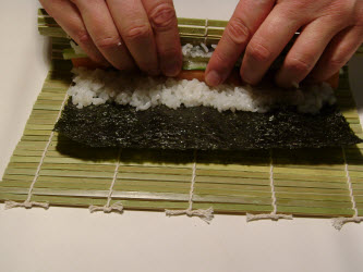 Continue rolling and holding fillings in place...