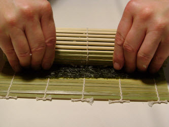 Stop when mat touches nori on other side of the roll...