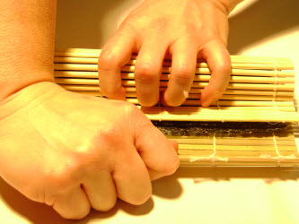 Tighten up the roll by tugging first with your left hand in the center