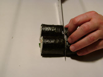 Set the 2 halves side by side and slice in the center again