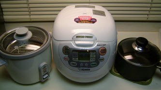 From left to right: Standard 1 button rice cooker, fancy rice cooker, and a pot