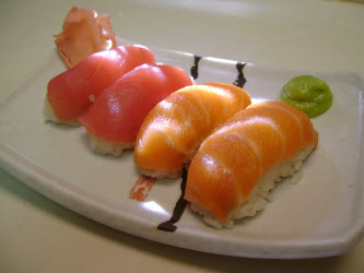 Salmon and Tuna Nigiri sushi on white sushi plate