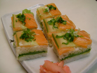 Finished salmon and cucumber pressed sushi