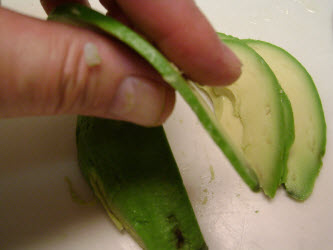 Showing how thin the avocado is sliced