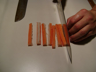 Slicing crab meat stick in half