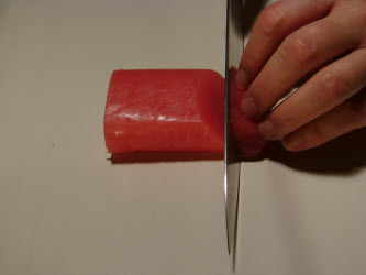 Slicing tuna using a straight cut at a 45 degree angle