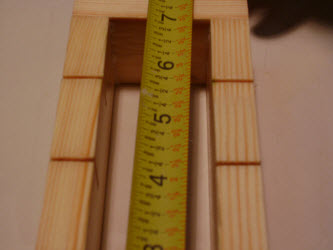 Measuring length of oshibako showing it is 7 inches long inside measurements