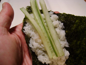 You can add some veggies like slivered cucumber or avocado to your spicy tuna hand roll