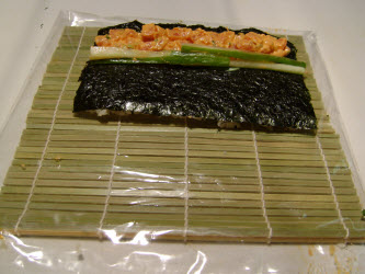 Add 2 or 3 slivered cucumbers in front of the spicy tuna if you want to add the crispy crunch to your roll...