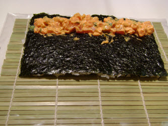 Add 1/4 of the spicy tuna over the wasabi