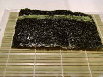 Swipe some wasabi across the nori a little closer to you than centered...