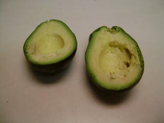 Splitting avocado in half