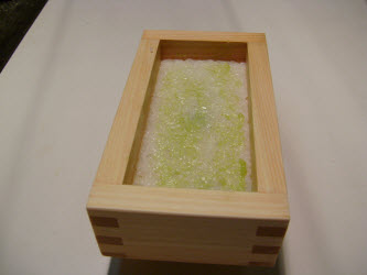 Wasabi spread over 2nd layer of rice