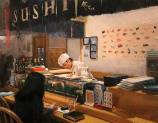 Customer at a sushi bar