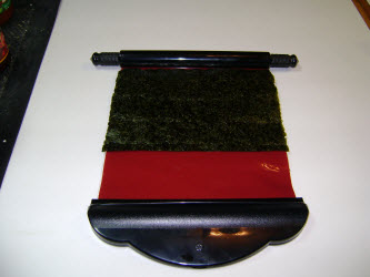 Putting nori on the sushi magic mat