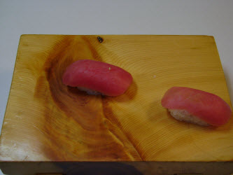 Here are two tuna nigiri just like they dropped out of the mold