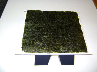 Lay a full sheet of nori on the mat...