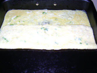 Fold over 1/3 of egg mixture in pan