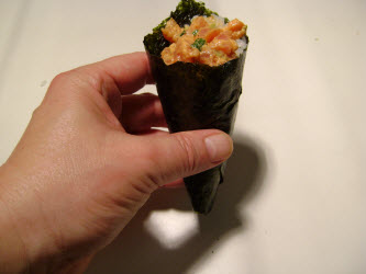 Spicy tuna hand roll ready to eat. But eat it quickly before the crispy nori gets soft!