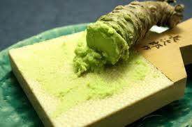 Grinding wasabi root on a sharkskin grinder