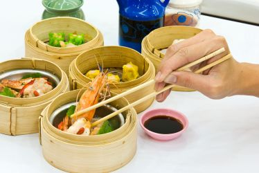 Picking up food with chopsticks