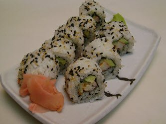 California roll with black and white sesame seeds on the outside