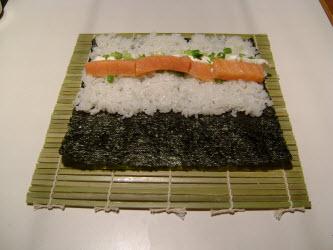 Adding smoked salmon to chumaki roll