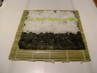 Spreading wasabi on rice for chumaki roll