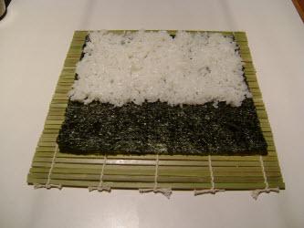 Sushi rice spread on nori for chumaki roll