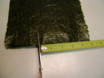 Measuring 5 inches on 8 inch side and cutting the nori sheet down to 5x7